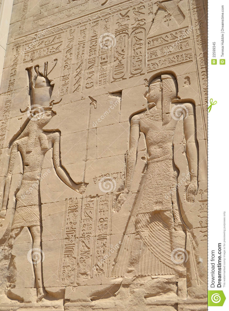 Egyptian hieroglyphic carvings on a wall royalty free