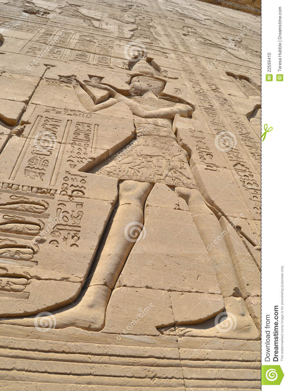 Egyptian hieroglyphic carvings on a wall stock photo