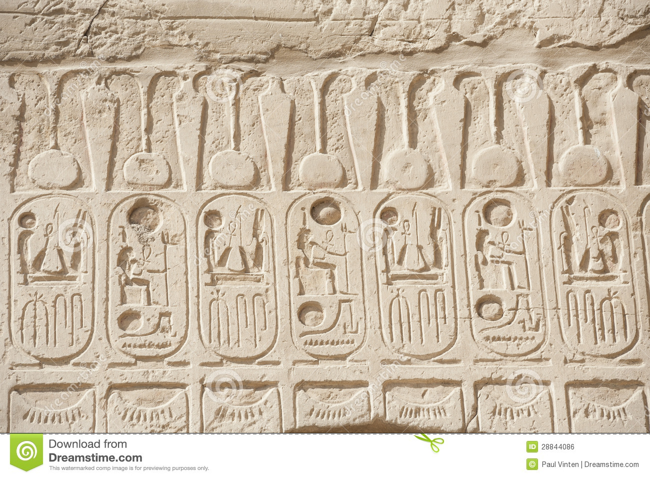 Egyptian hieroglyphic carvings on wall royalty free stock