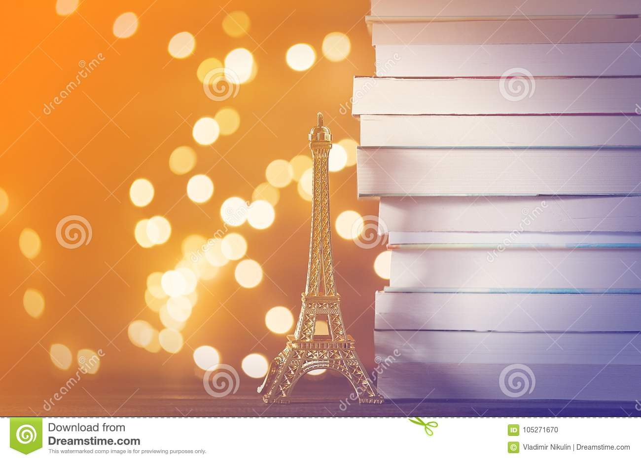 Eiffel tower gift and pile of books with Fairy lights