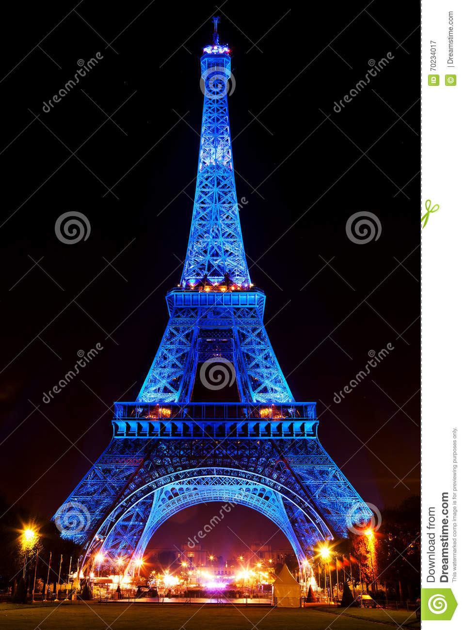 Eiffel Tower Glowing Blue Illuminated At Night In Paris, France ...