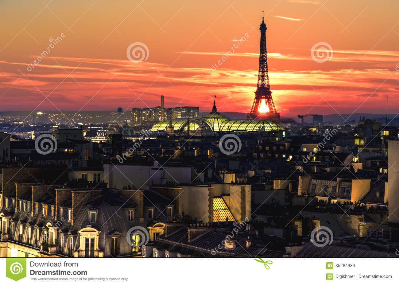 Eiffel tower over the roofs crowd