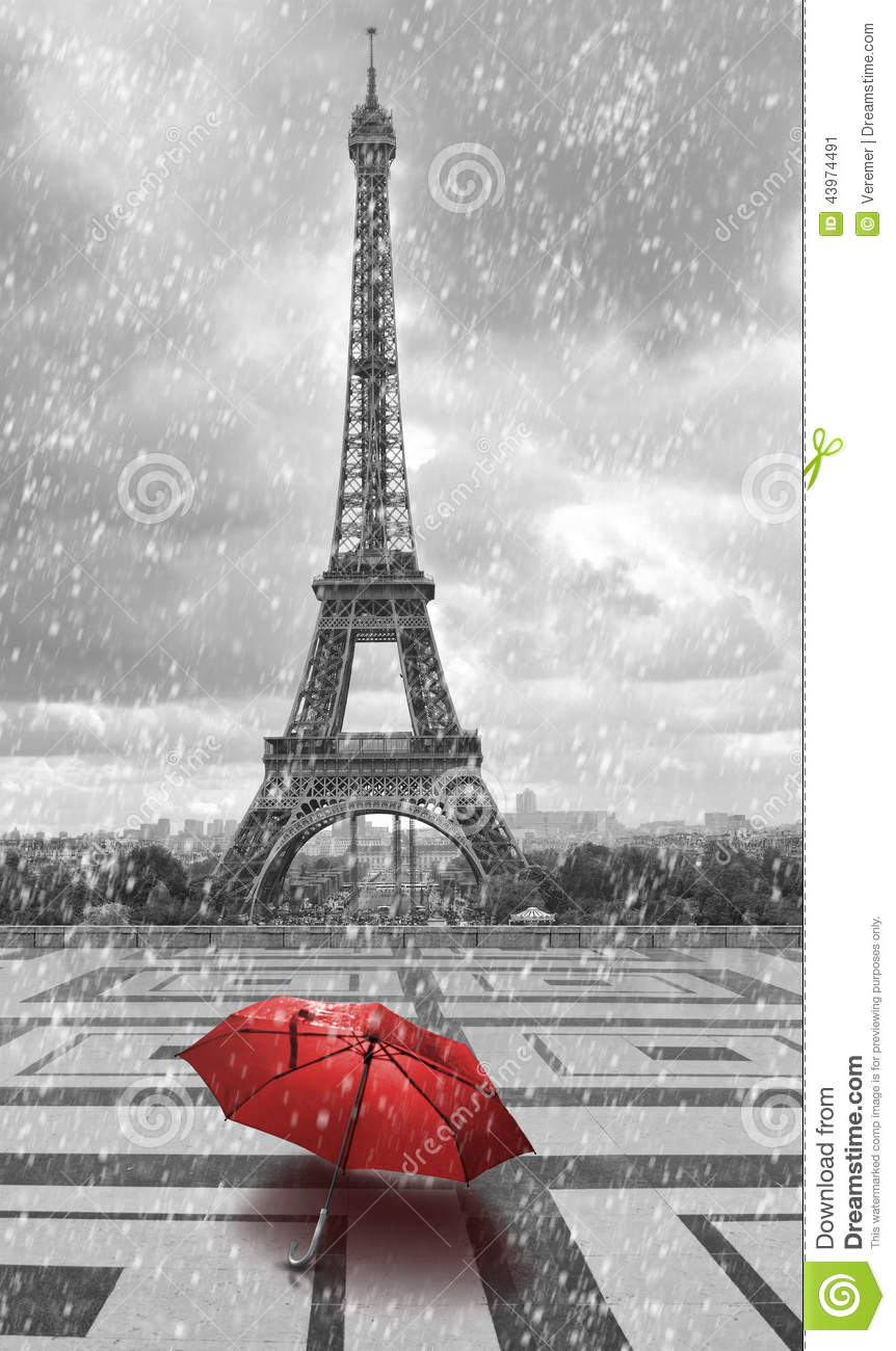 Eiffel tower in the rain with red umbrella black and white photo with red element