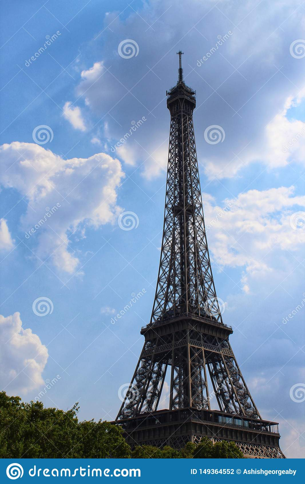 Eiffel tower touching the clouds
