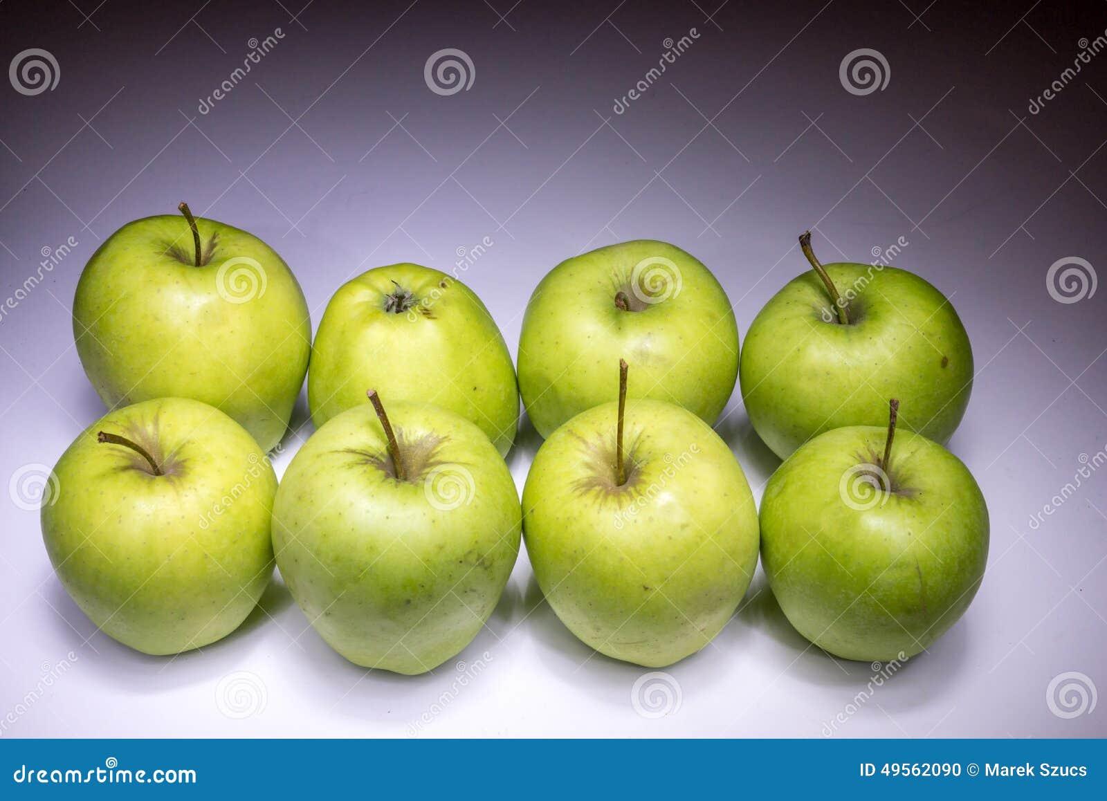 Eight green apples