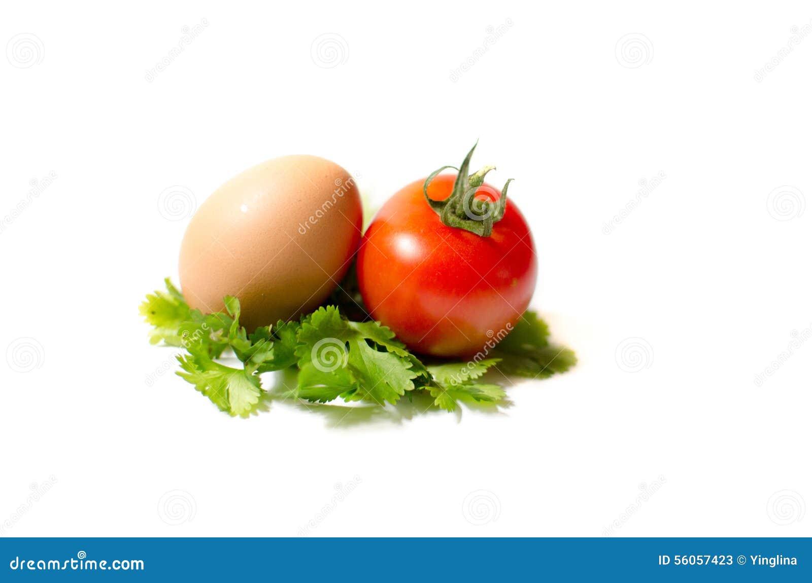 ein ei und eine tomate auf einem blatt von parshley stockbild bild 56057423. Black Bedroom Furniture Sets. Home Design Ideas