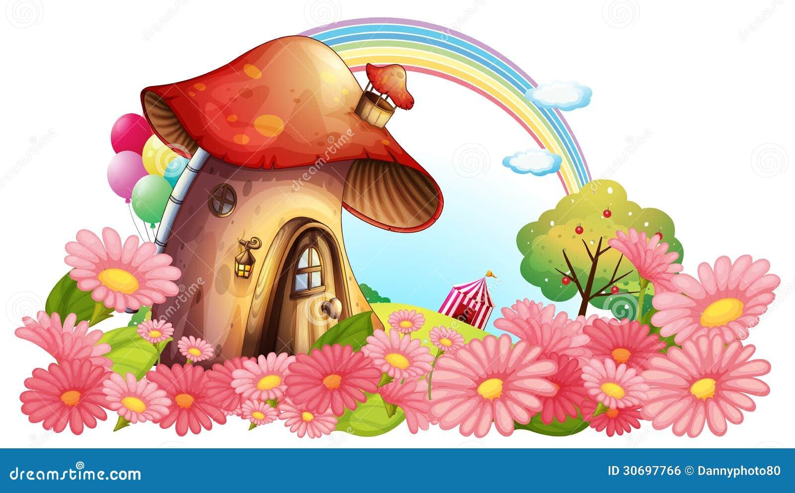 Ein Pilzhaus mit einem Garten von Blumen