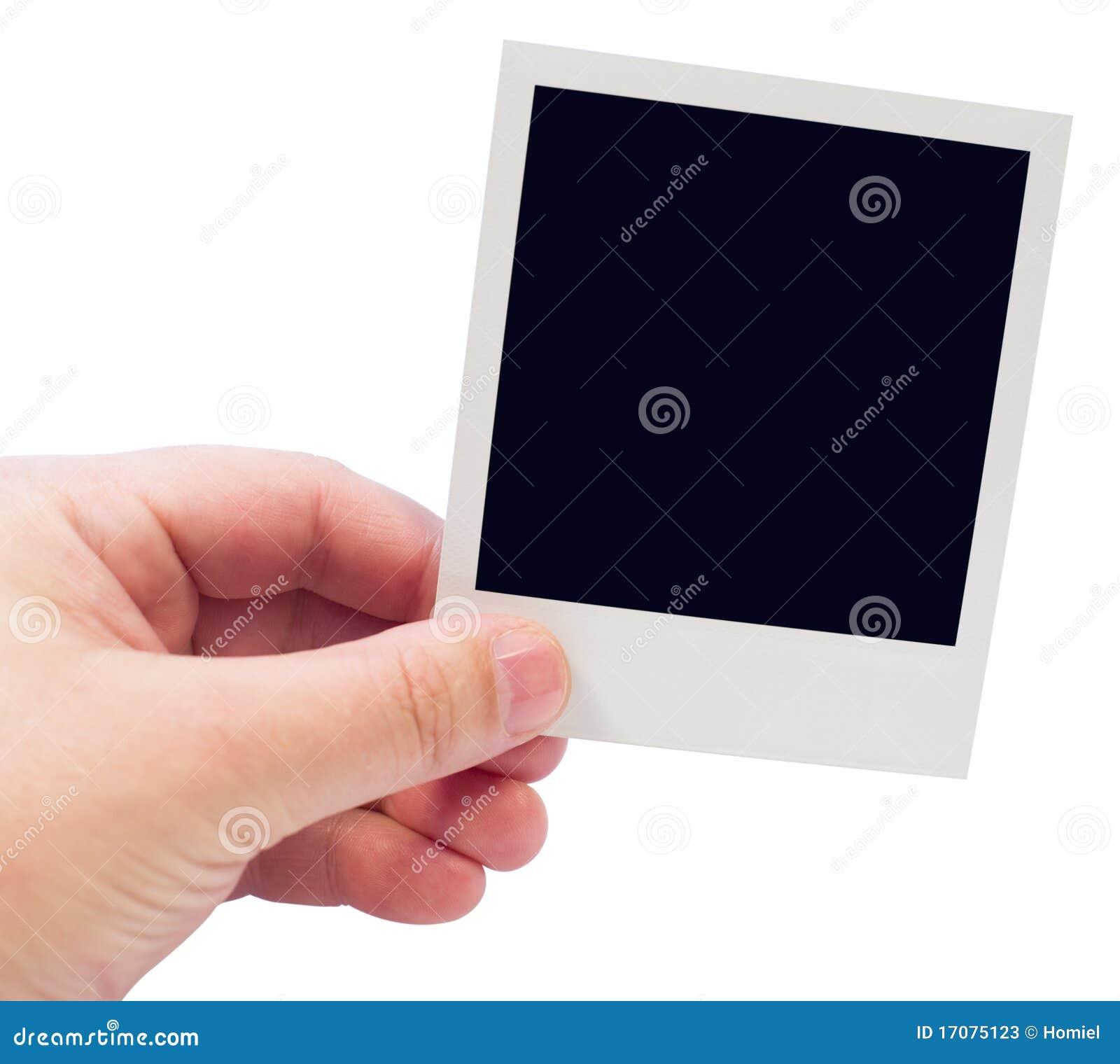 Ein Polaroid in der Hand