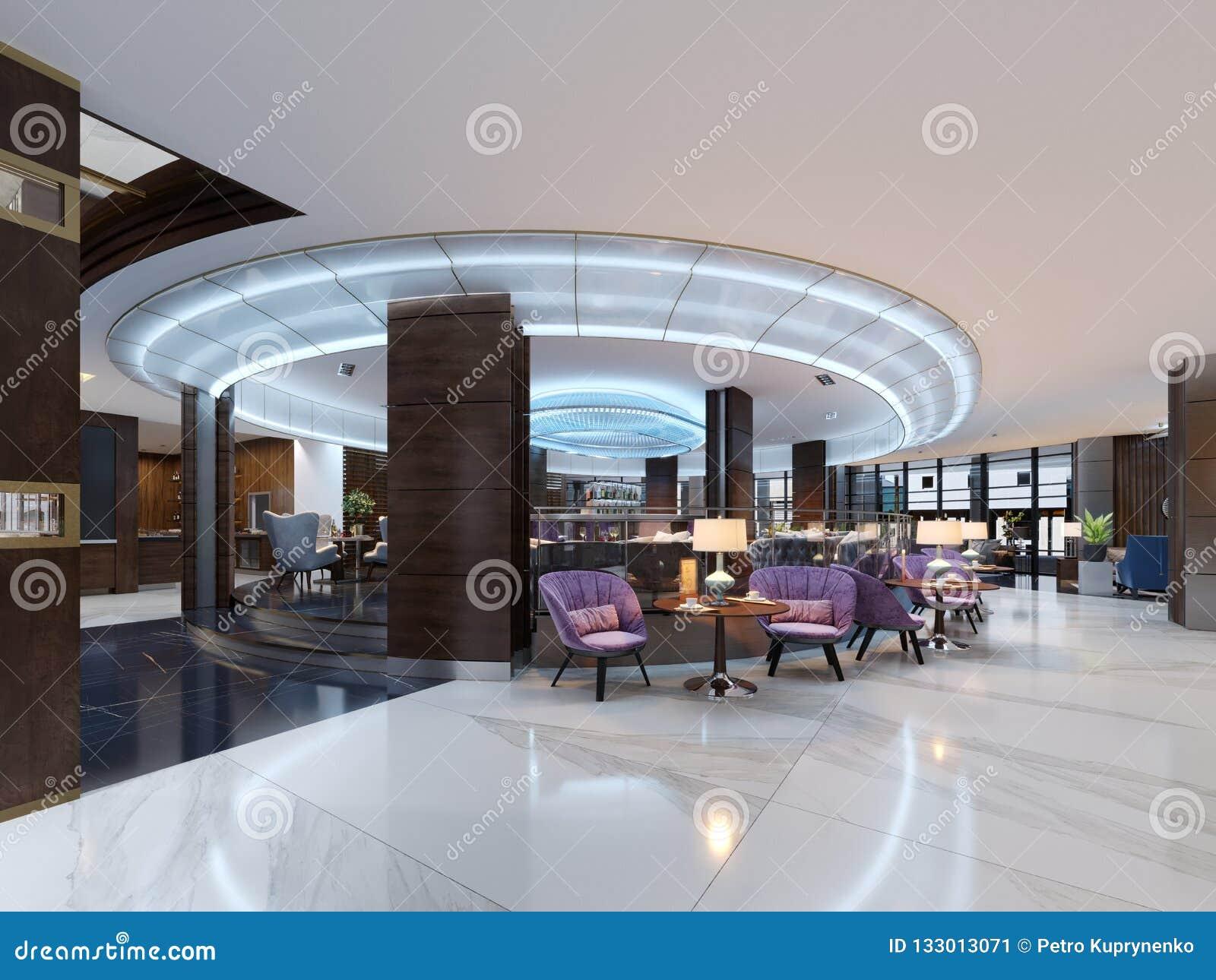 Eine gemütliche Cafeteria in der Lobby mit bequemen gepolsterten Stühlen und in einer Tabelle mit einer Lampe