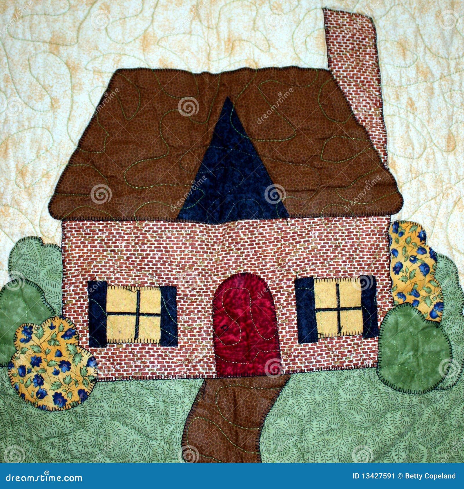 einfaches haus auf einer steppdecke stockbild bild 13427591. Black Bedroom Furniture Sets. Home Design Ideas