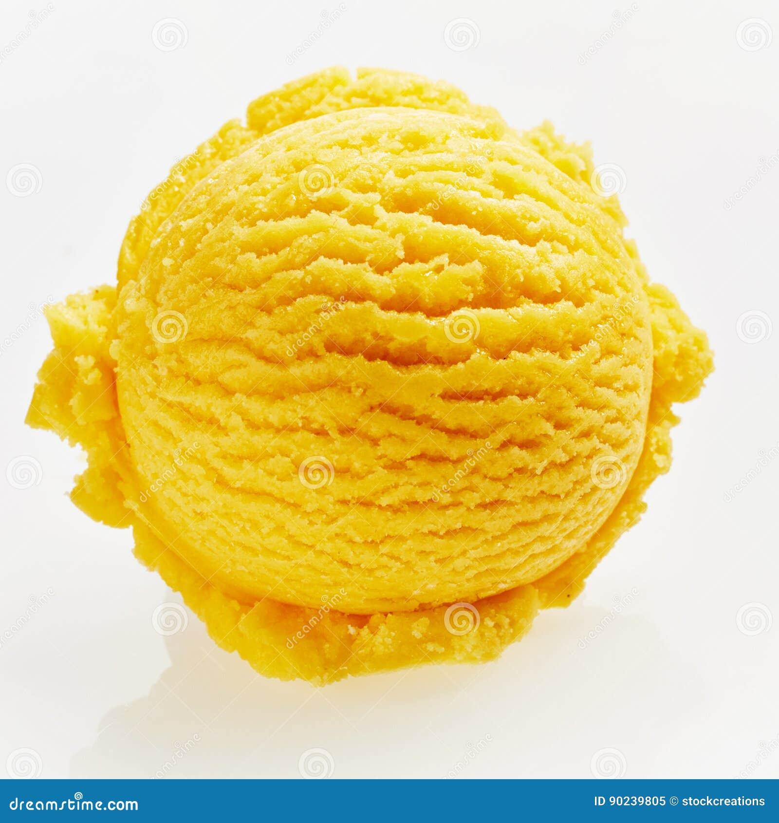 Einzelne Schaufel der gelb-orangeen Eiscreme