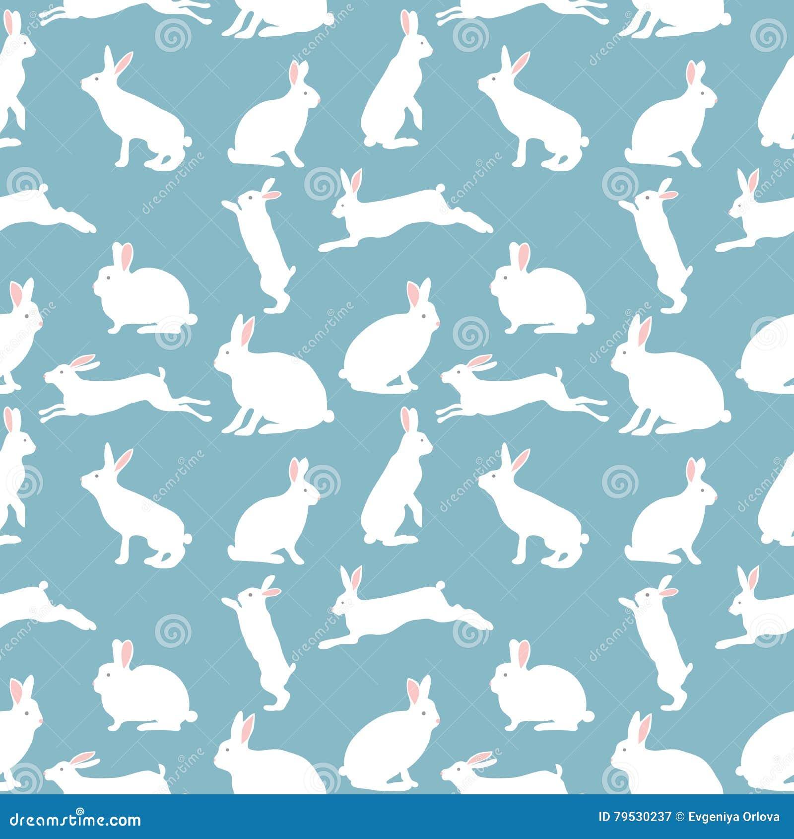 Ejemplo lindo del conejo, modelo inconsútil en fondo azul