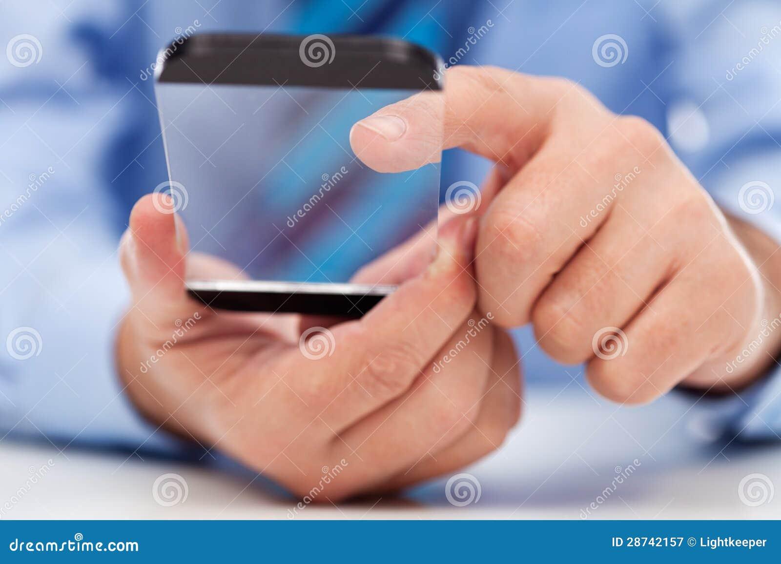 Ekran sensorowy gadżet w biznesmen rękach