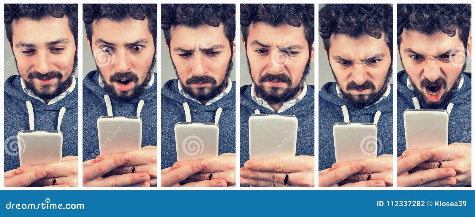 Ekspresyjny młody człowiek używa smartphone
