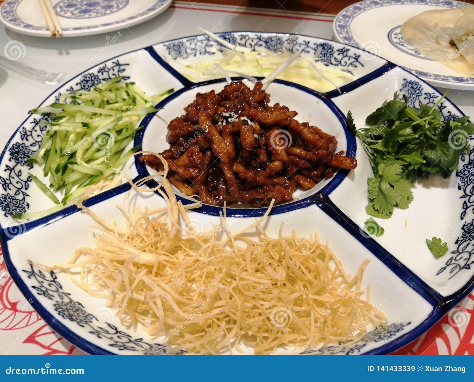 El bocado chino septentrional de la especialidad se llama torta de la primavera