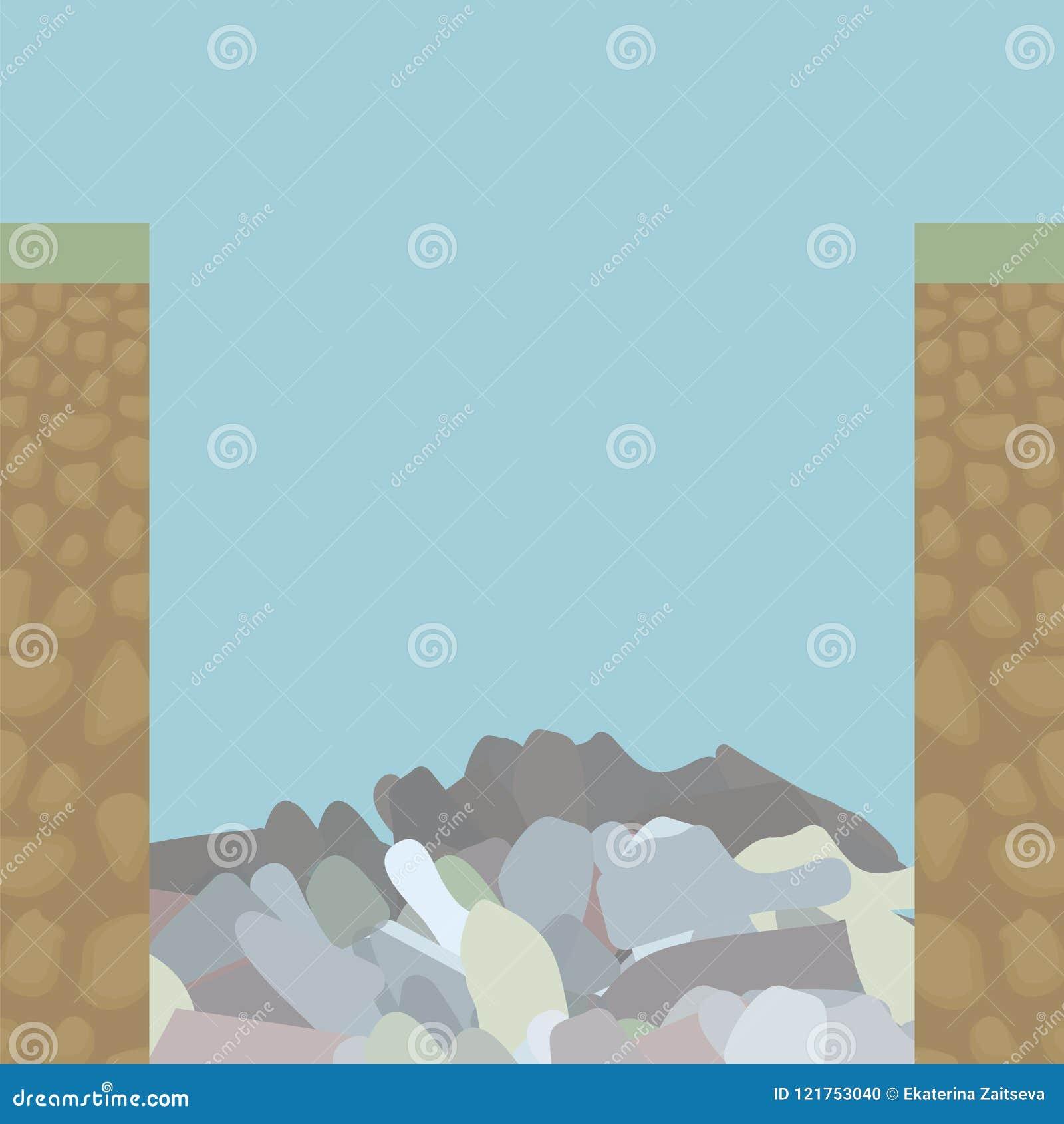 El borde dos cortó el borde de la rebanada del suelo desde adentro debajo de hierba, de una tierra marrón con las piedras redonde