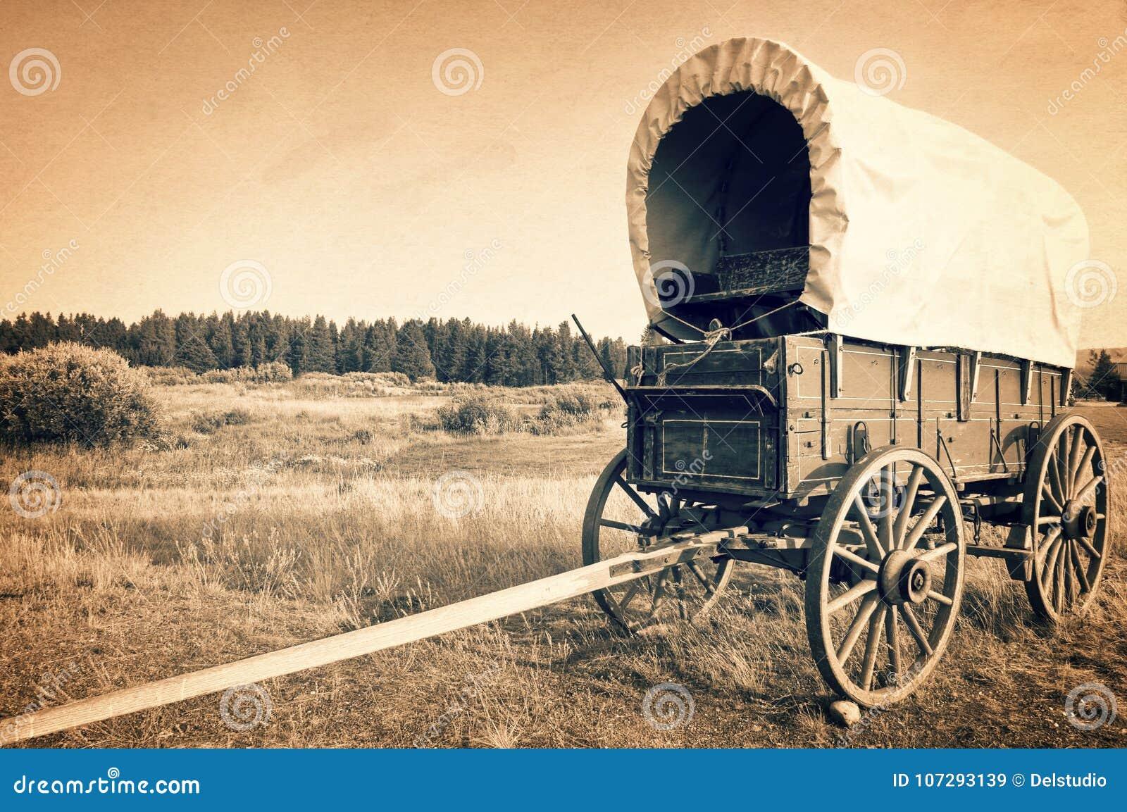 El carro occidental americano del vintage, proceso del vintage de la sepia, vaquero americano mide el tiempo de concepto