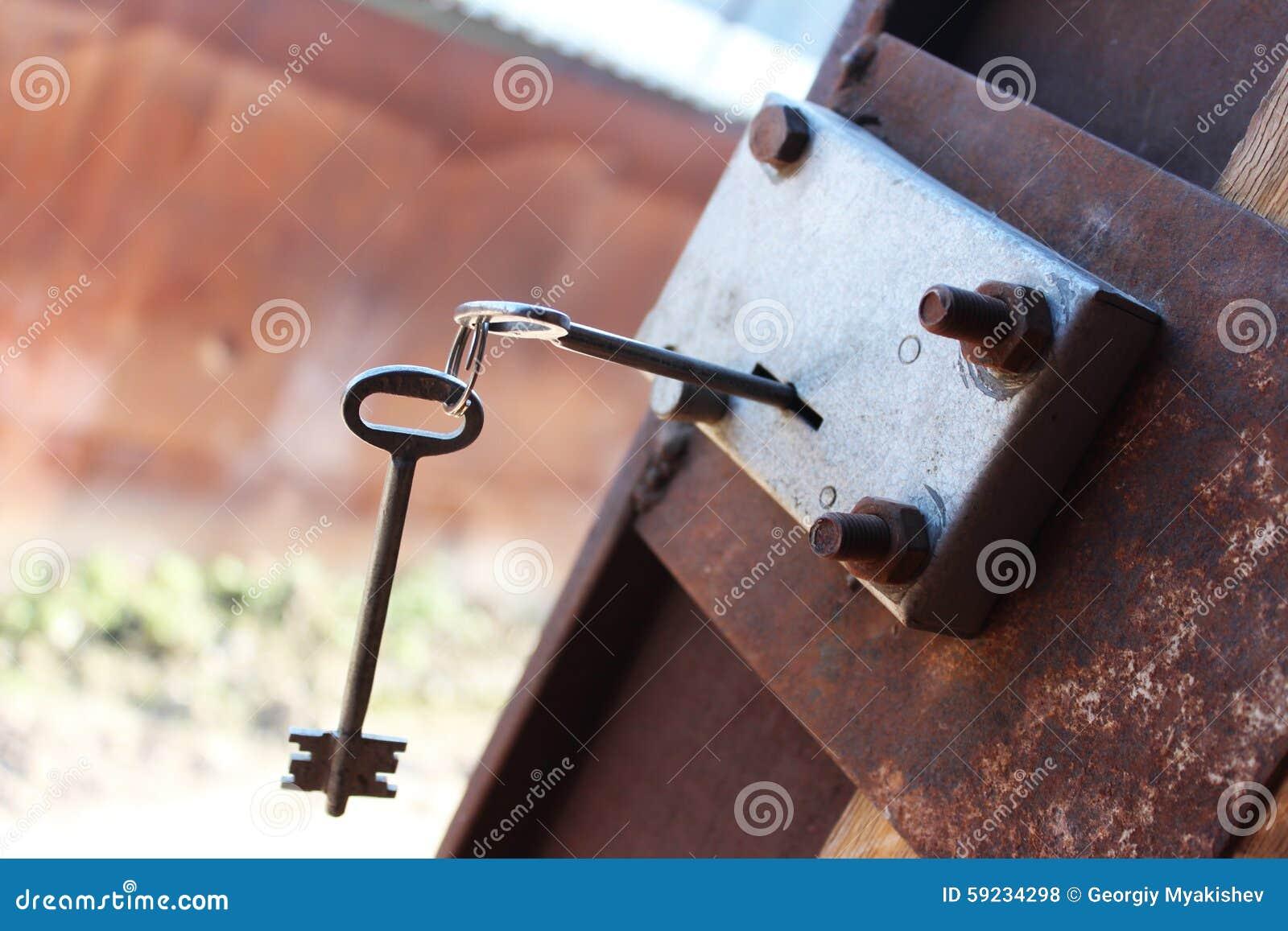 Download El clave en el bloqueo foto de archivo. Imagen de entrada - 59234298