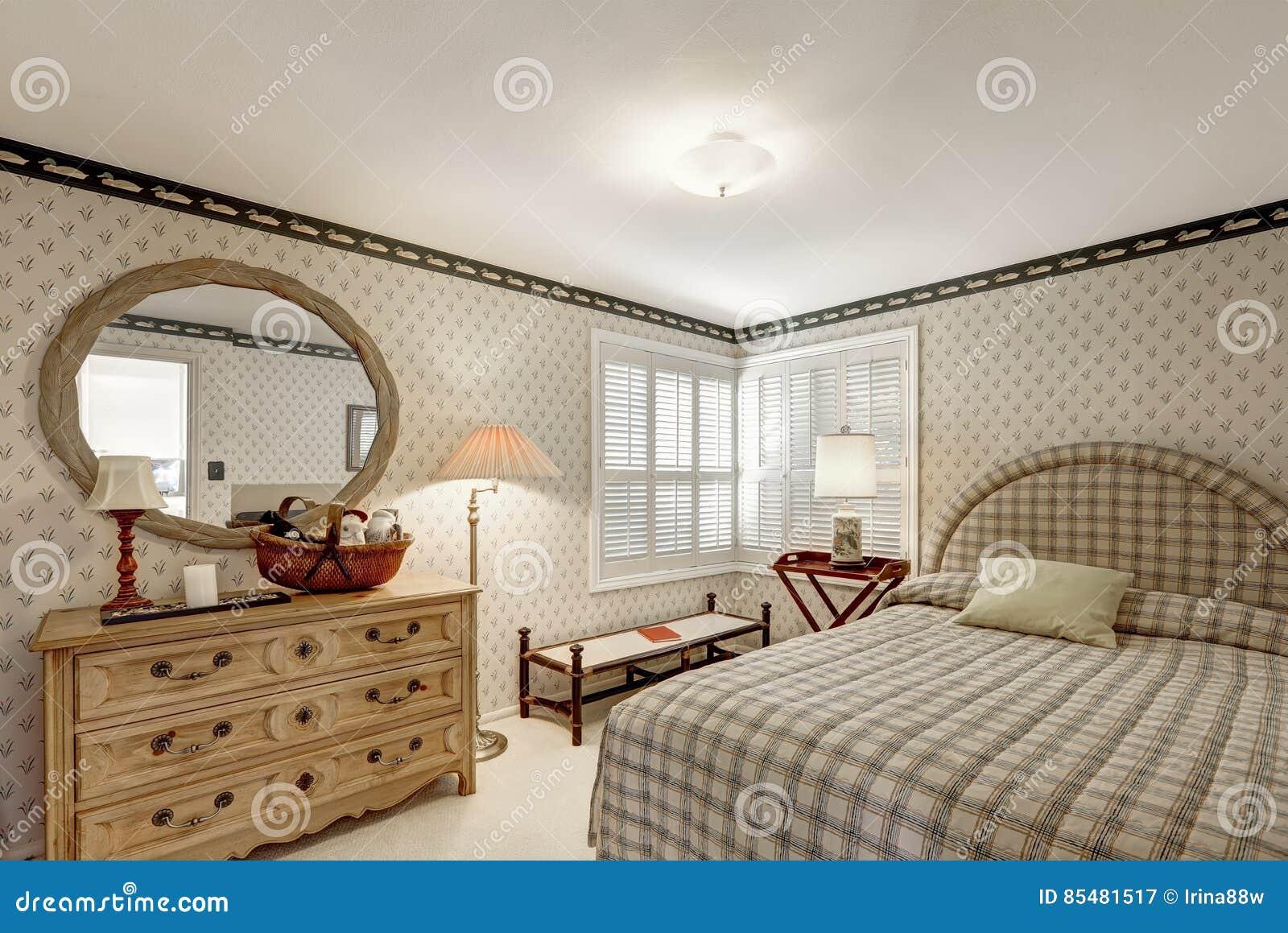 El dise o acogedor del dormitorio en tonos grises ofrece for Lenceria de dormitorio 3