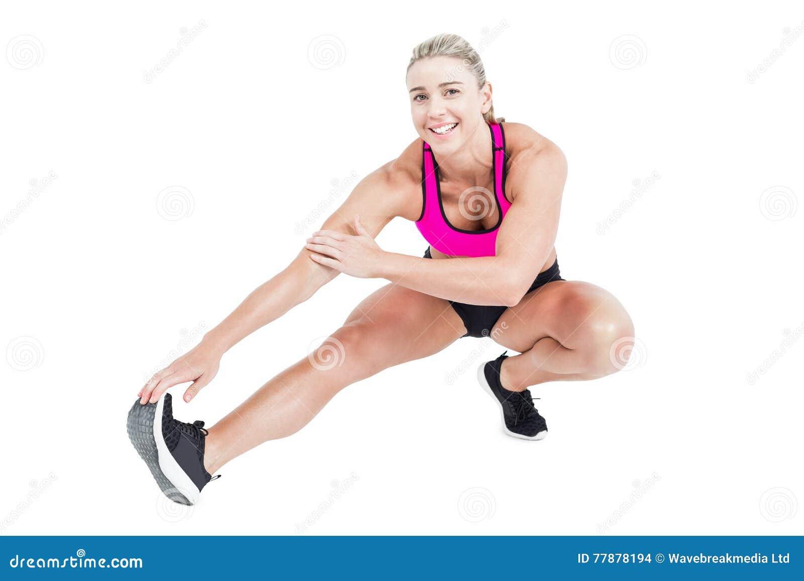 El Estirar Femenino Del Atleta Foto de archivo