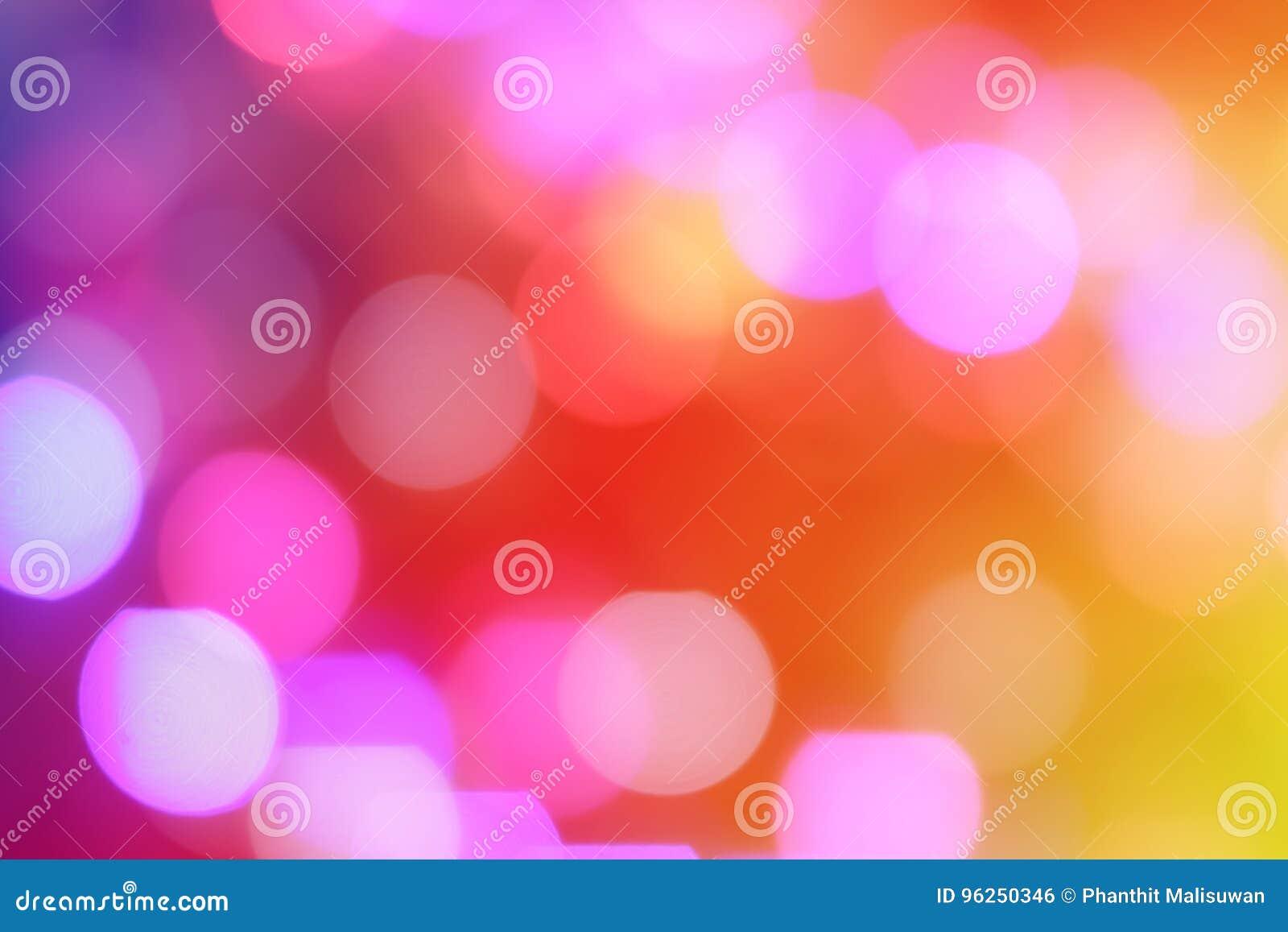 El extracto colorido empañó la luz circular del bokeh de la ciudad de la noche