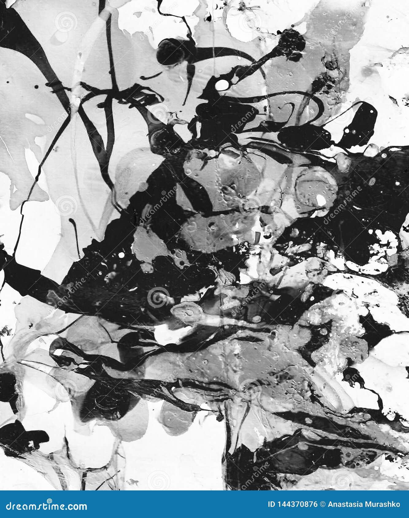 El fondo abstracto blanco y negro pintado a mano con la pintura salpica