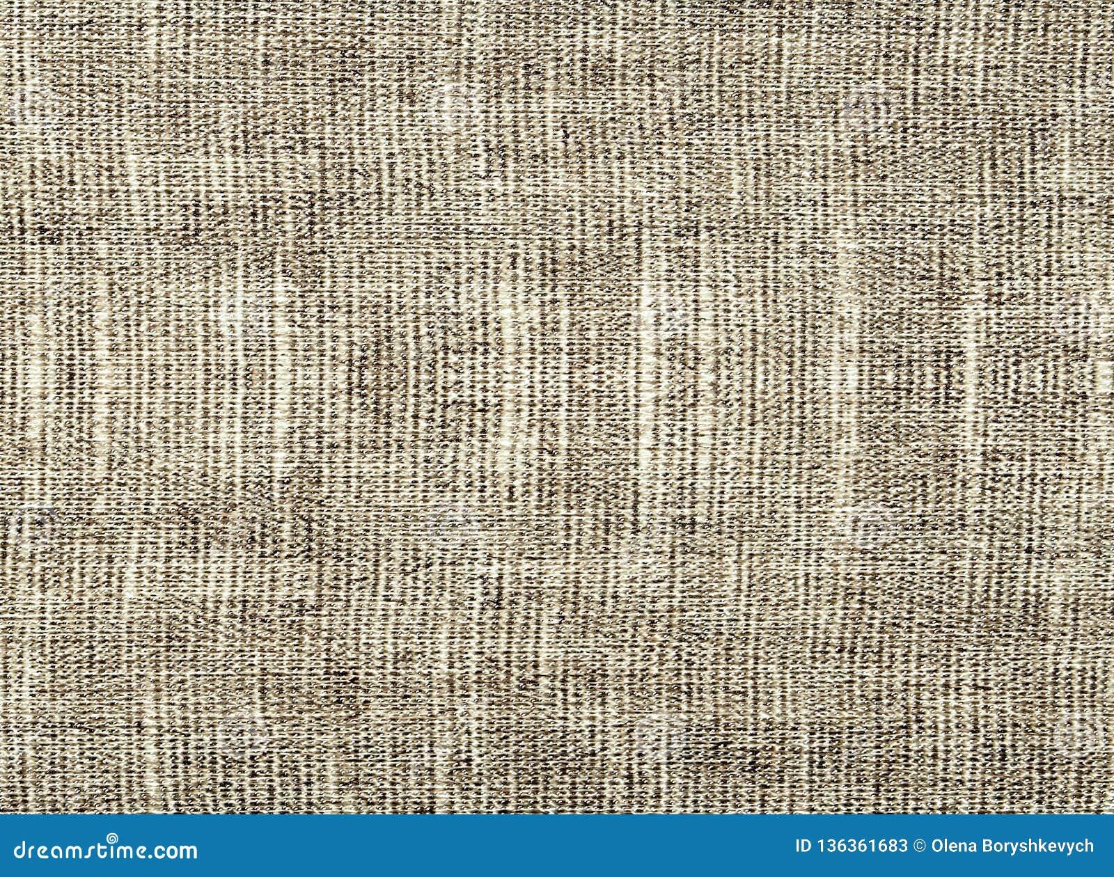 El fondo de la tela natural beige texturizada