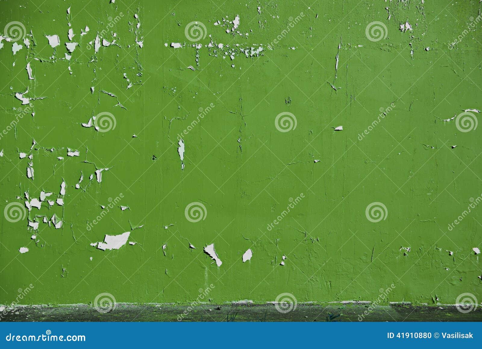 El fondo peló la pintura verde clara verde oliva en la pared