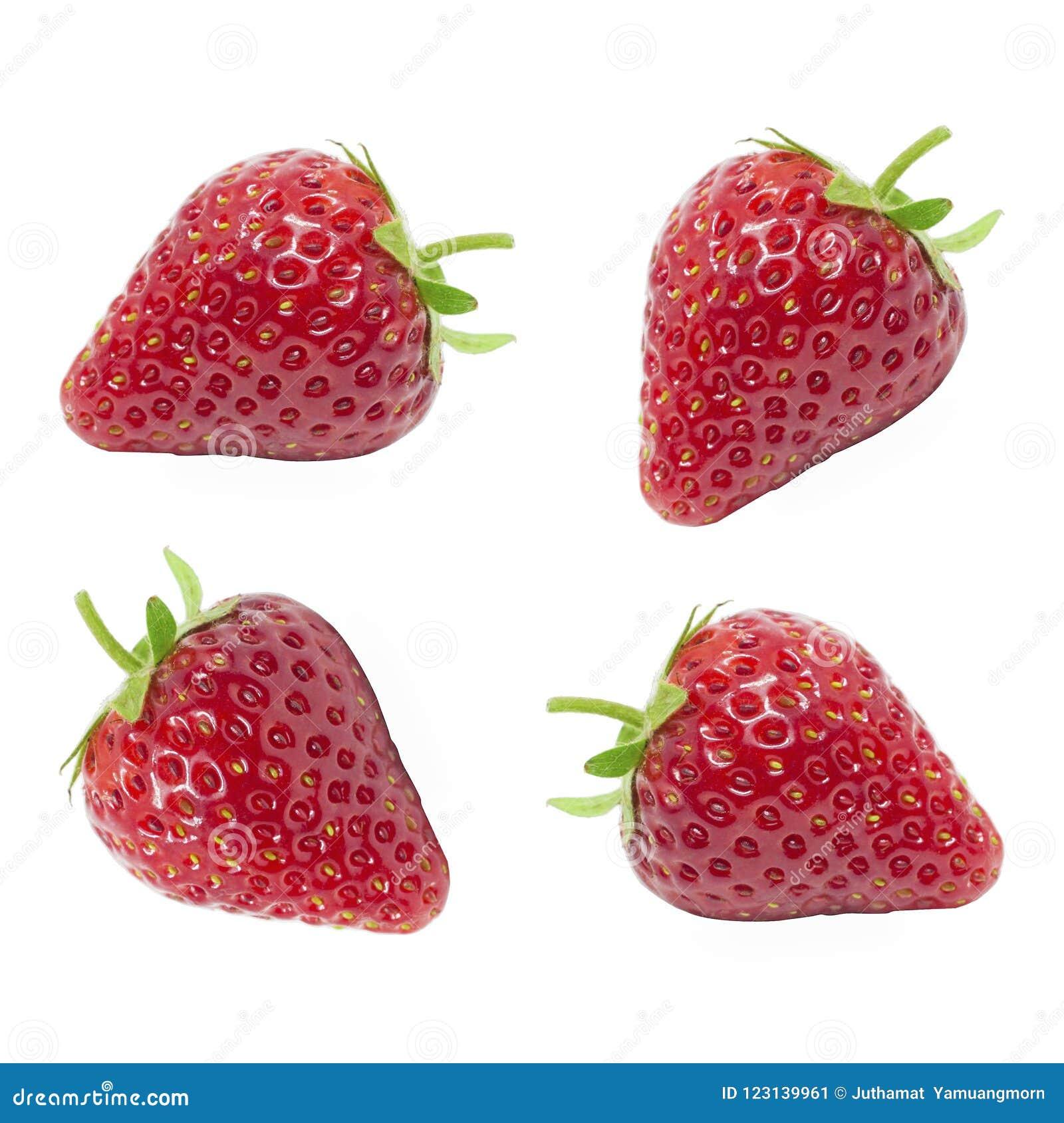El jugoso fresco de la fresa roja del sistema aislada en el fondo blanco