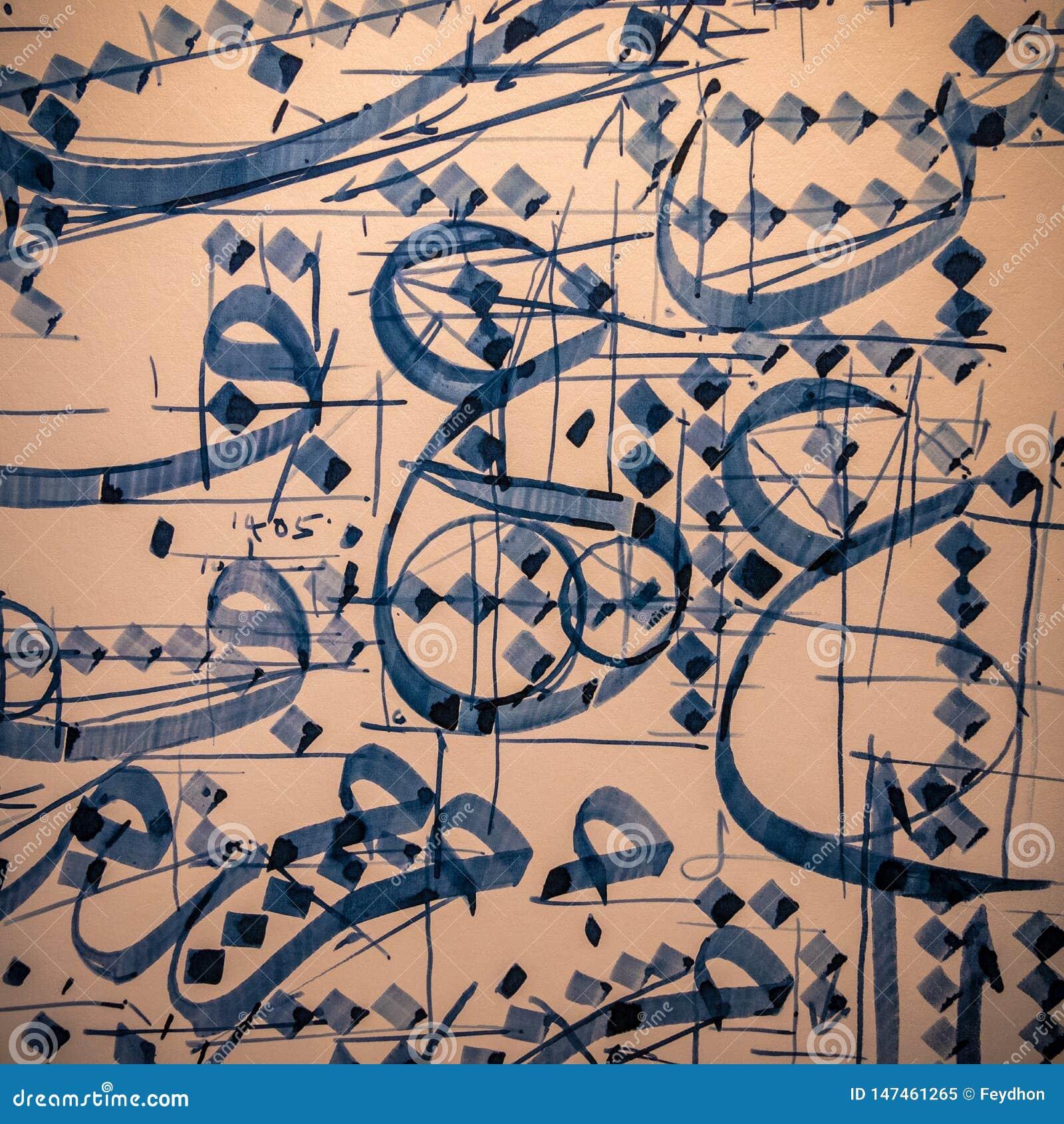 El khat tradicional de la caligraf?a ?rabe e isl?mica practica en tinta azul