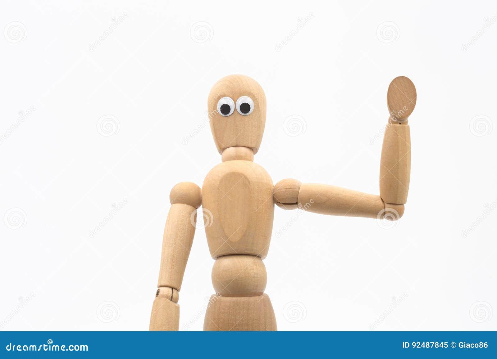 El maniquí de madera con los ojos googly dice hola - el fondo blanco