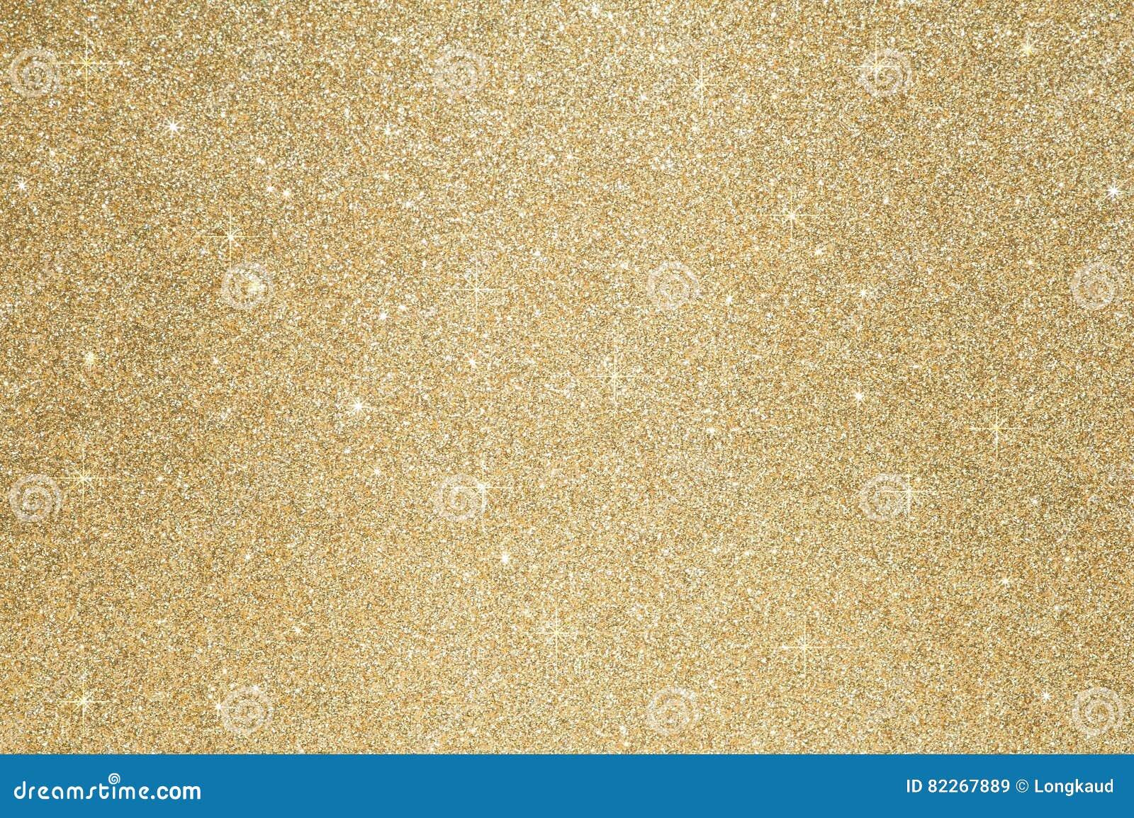 El oro abstracto Defocused del fondo del oro de la chispa del brillo se enciende en fondo
