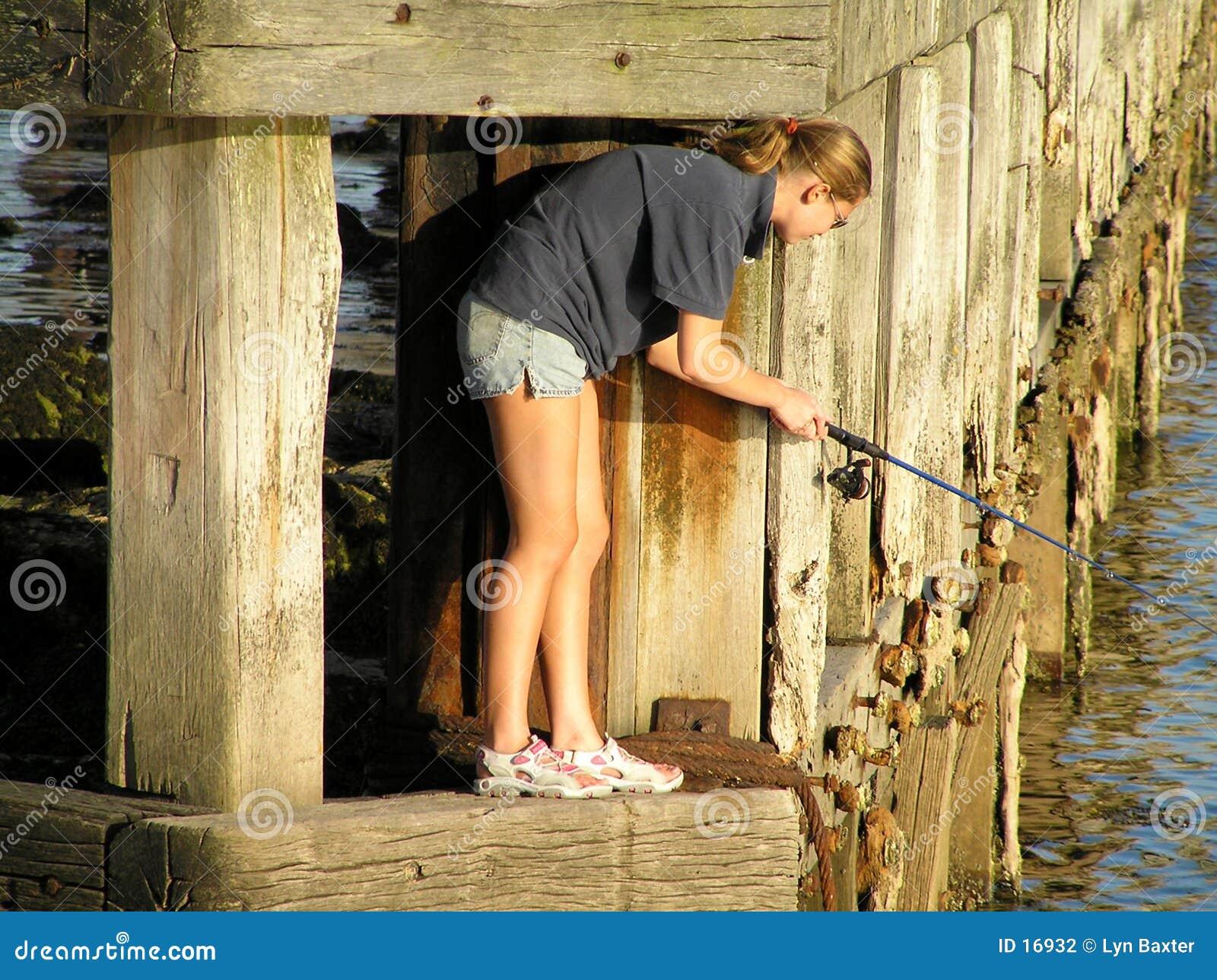 El pescar con caña femenino