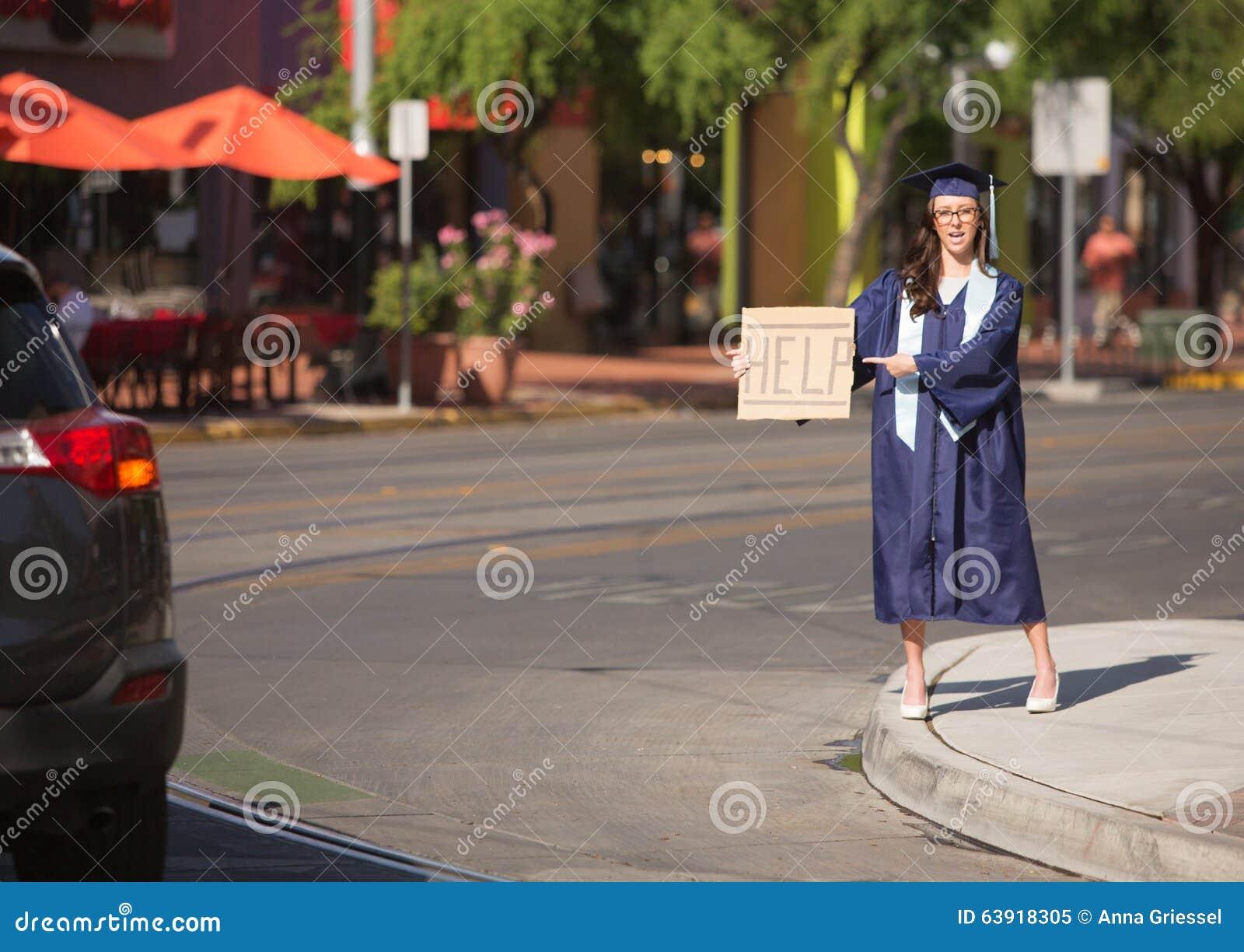 El señalar graduado a ayudar a firmar