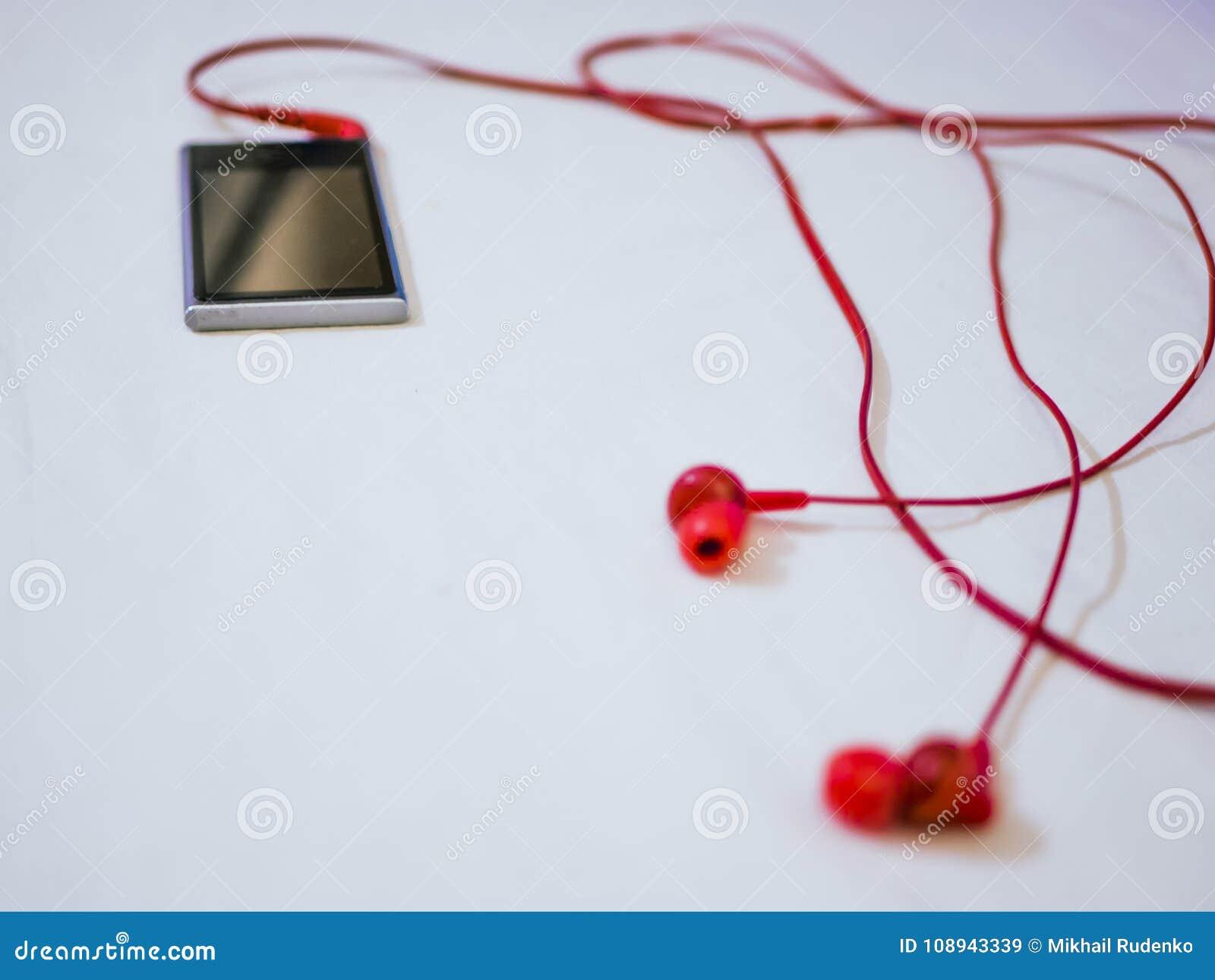 El Tiro Macro De Auriculares De Botón Conectó Con El