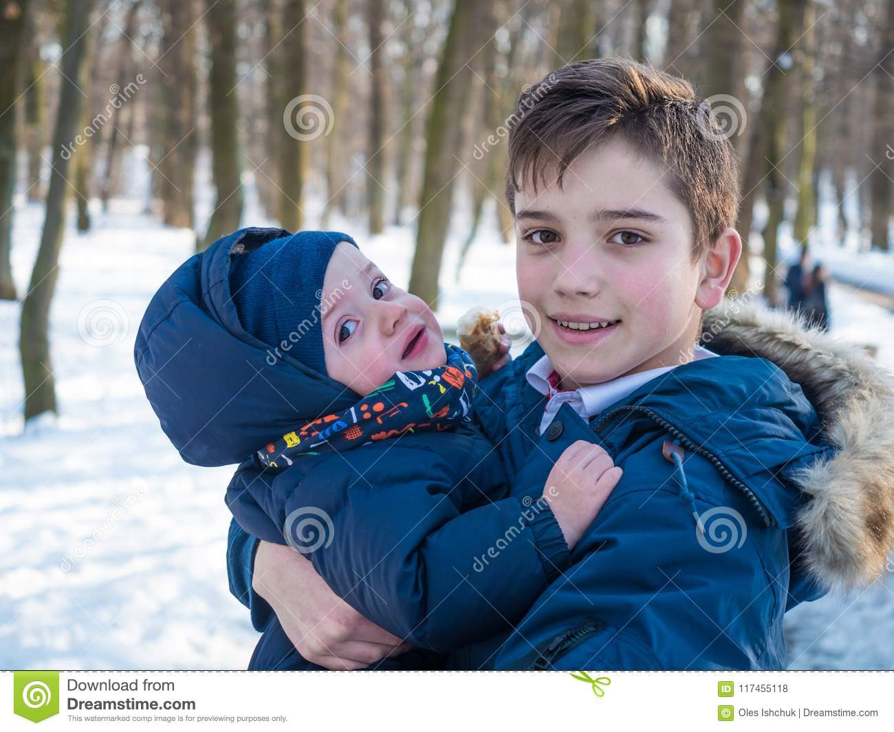 Two adorable brothers in winter park