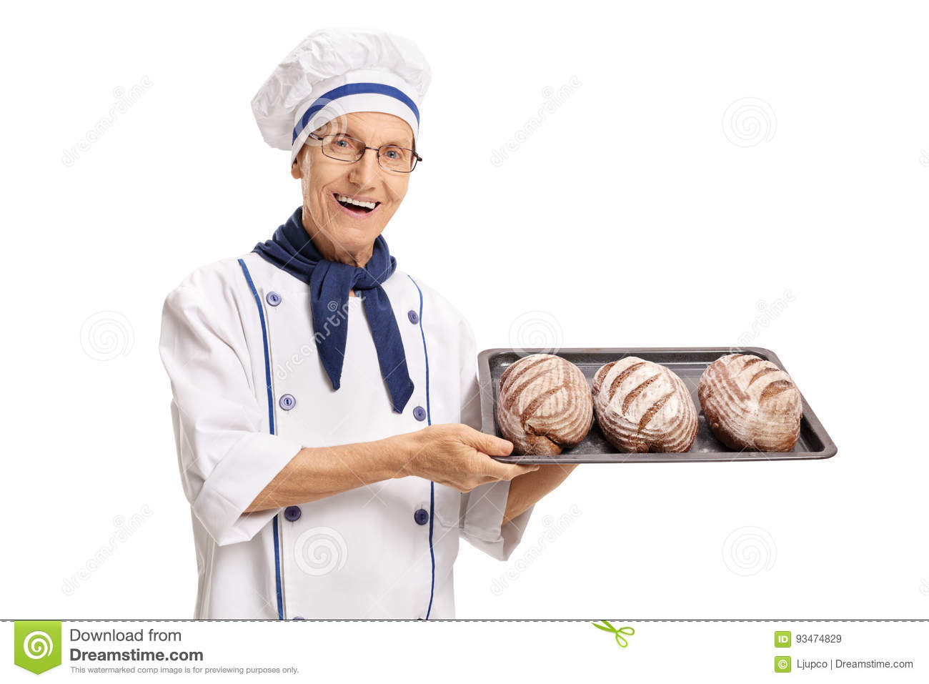 Elderly baker holding a tray with freshly baked breads