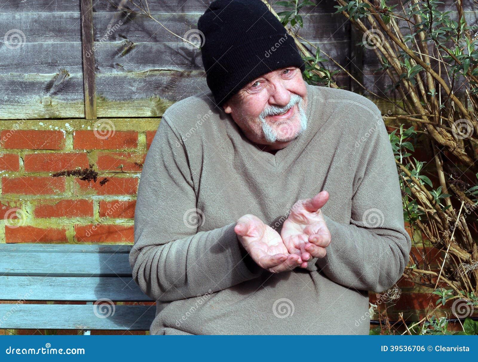 Elderly Beggar Holding Out Both Hand. Stock Photo - Image ...  Elderly Beggar ...
