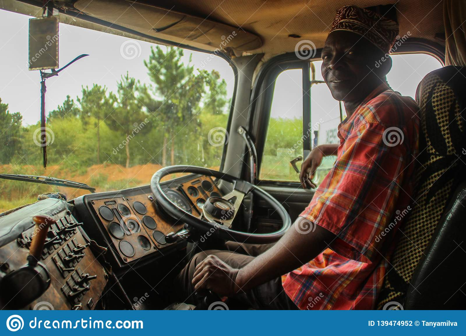 Elderly black African driver driving old truck
