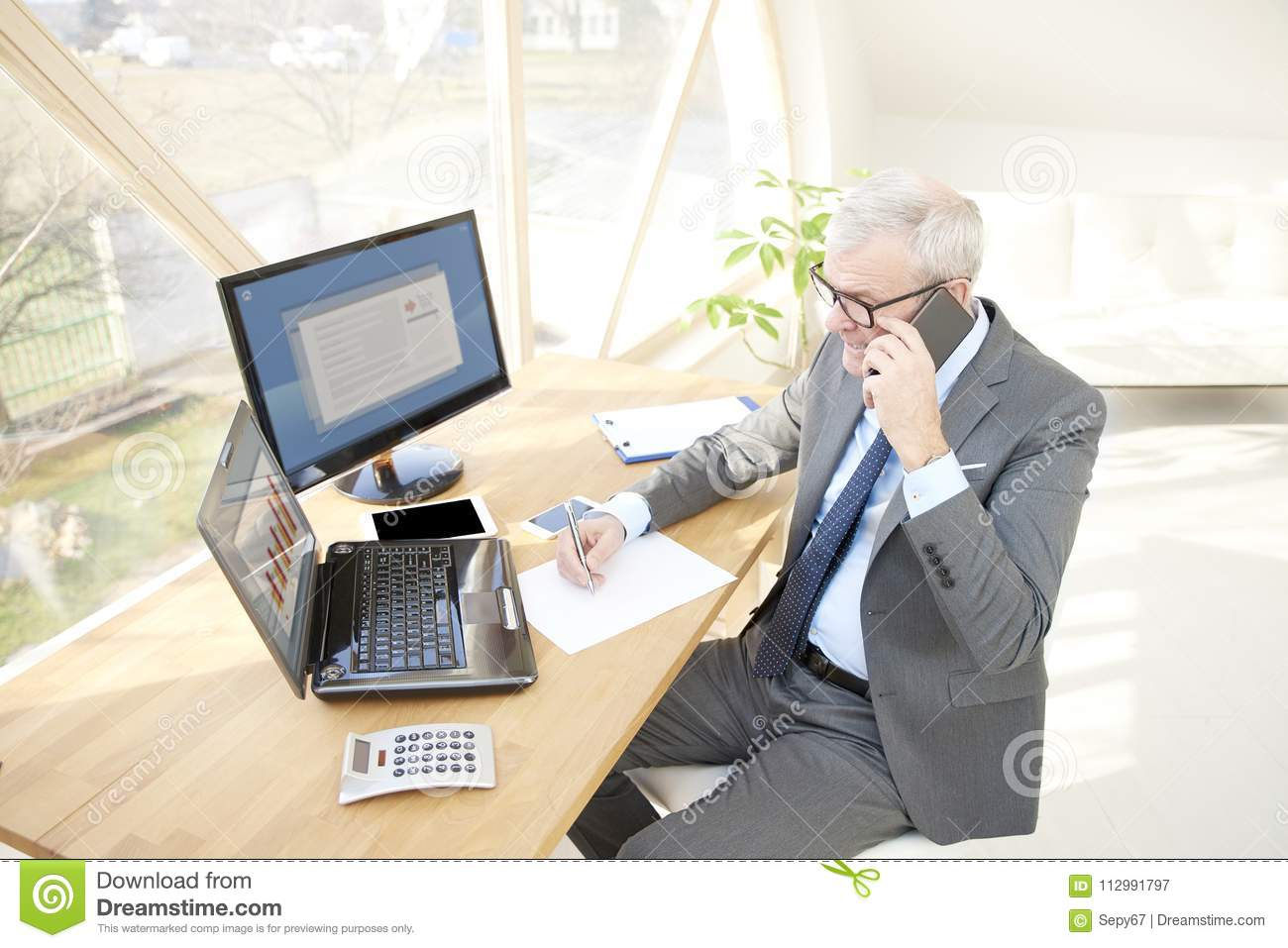 Elderly business working at the office