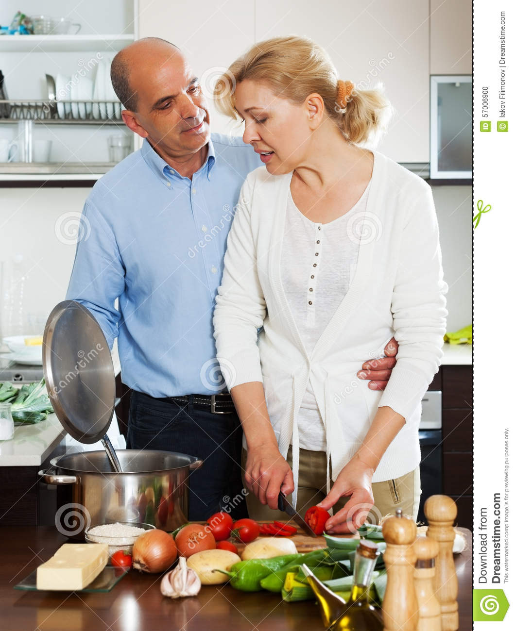 Elderly couple cooking soup