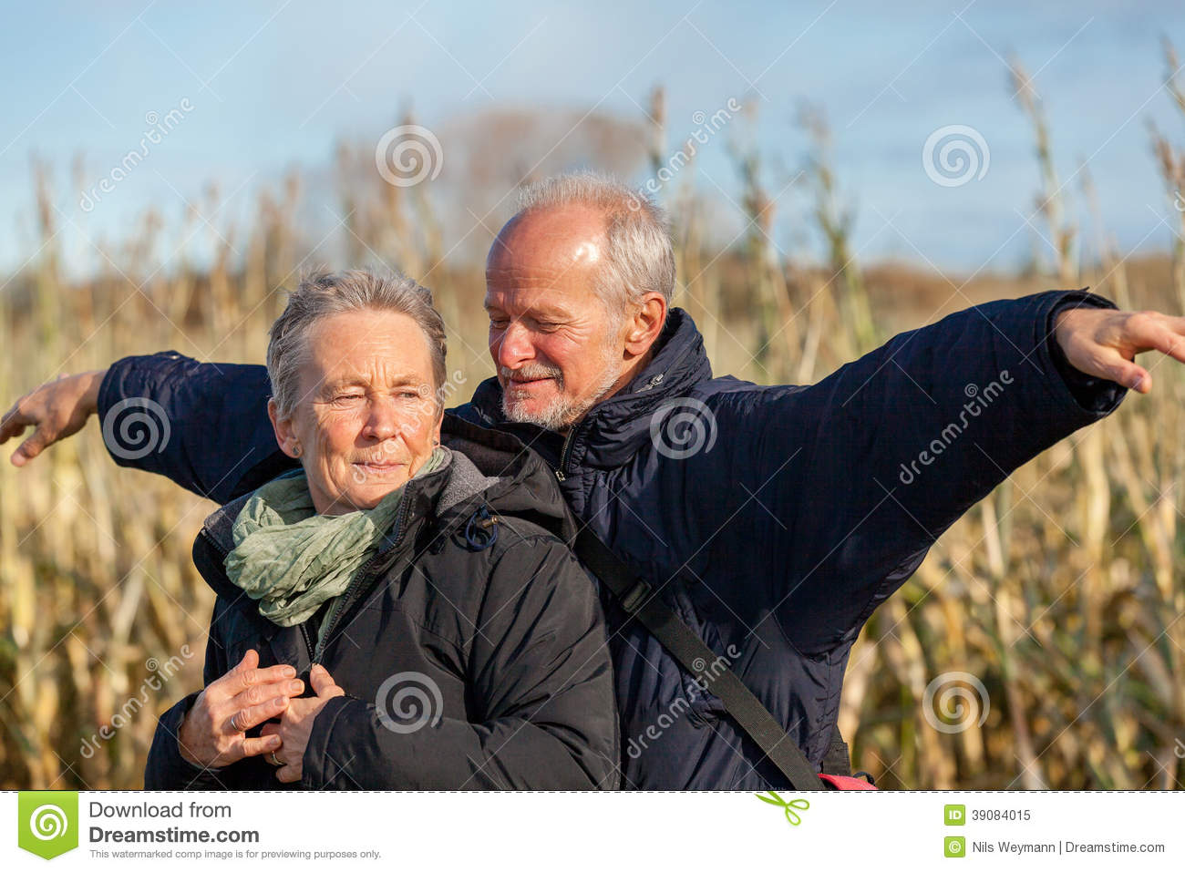 Elderly Couple Embracing And Celebrating The Sun Stock ...