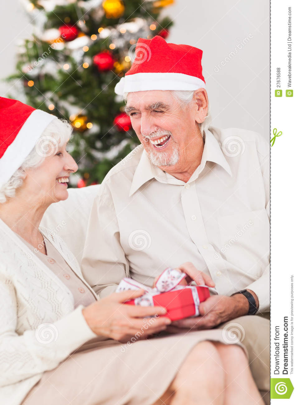 Elderly Couple Exchanging Christmas Gifts Stock Photo ...