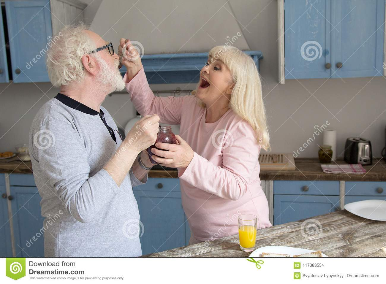 Elderly Couple Having Fun In Kitchen Stock Photo Image Of Woman