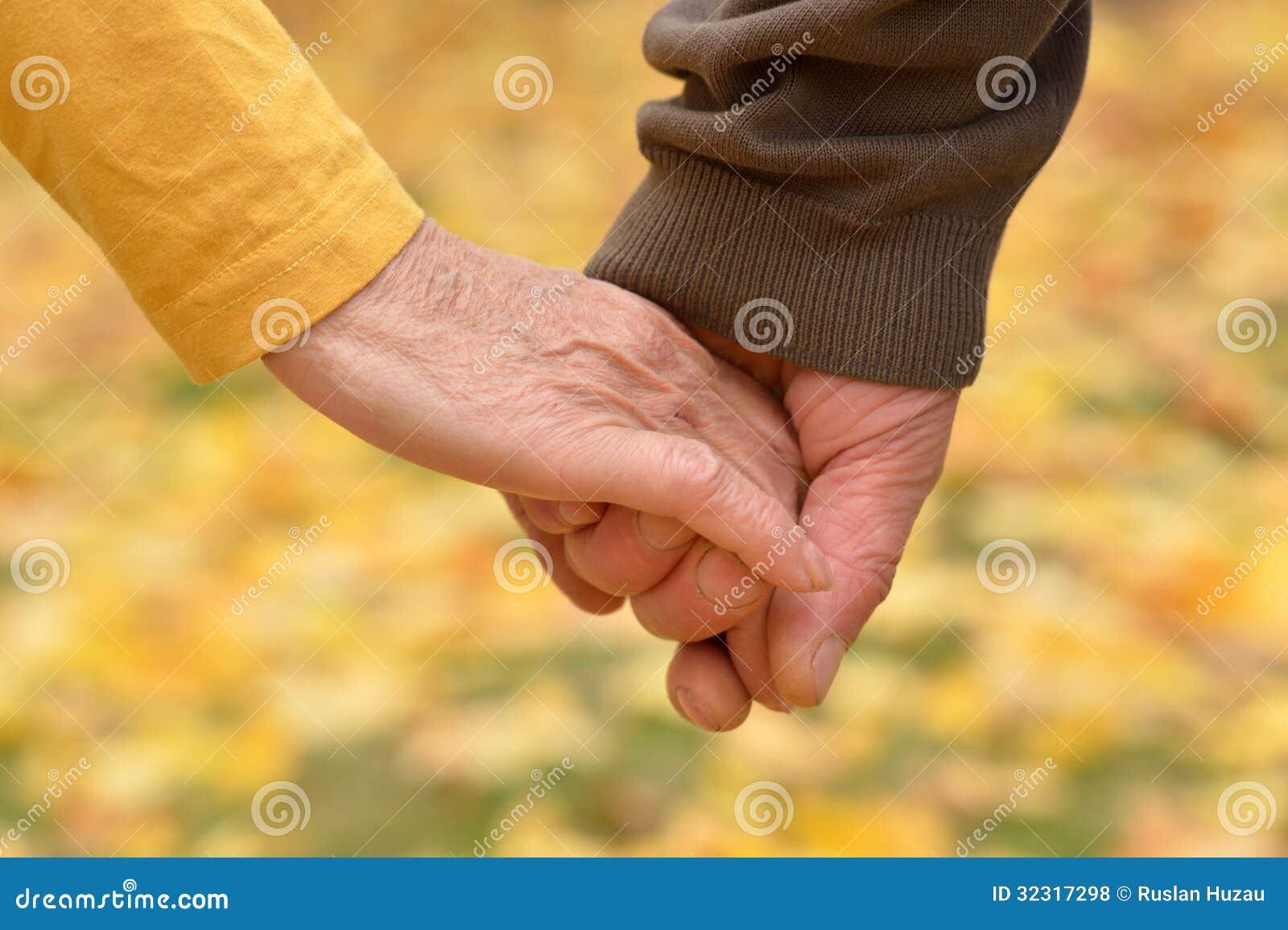 Elderly Couple Holding Hands Stock Photo - Image of lady