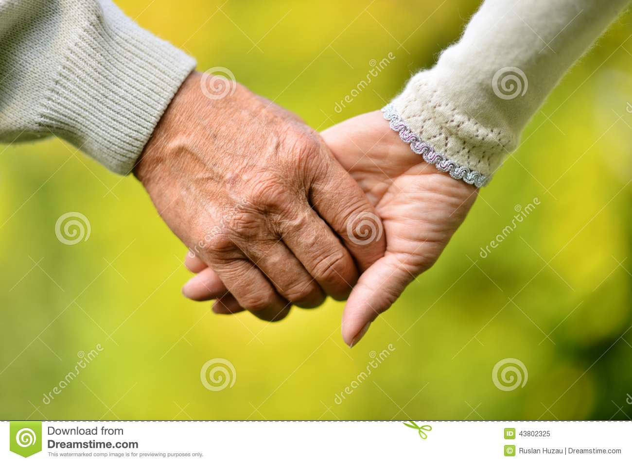 Elderly Couple Holding Hands Stock Image