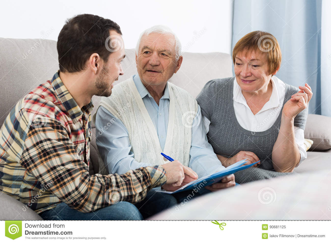 Elderly couple and insurance agent