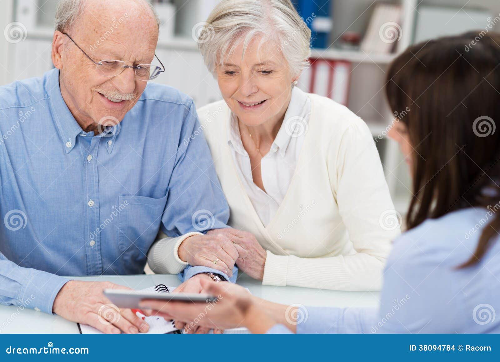 Elderly couple receiving financial advice