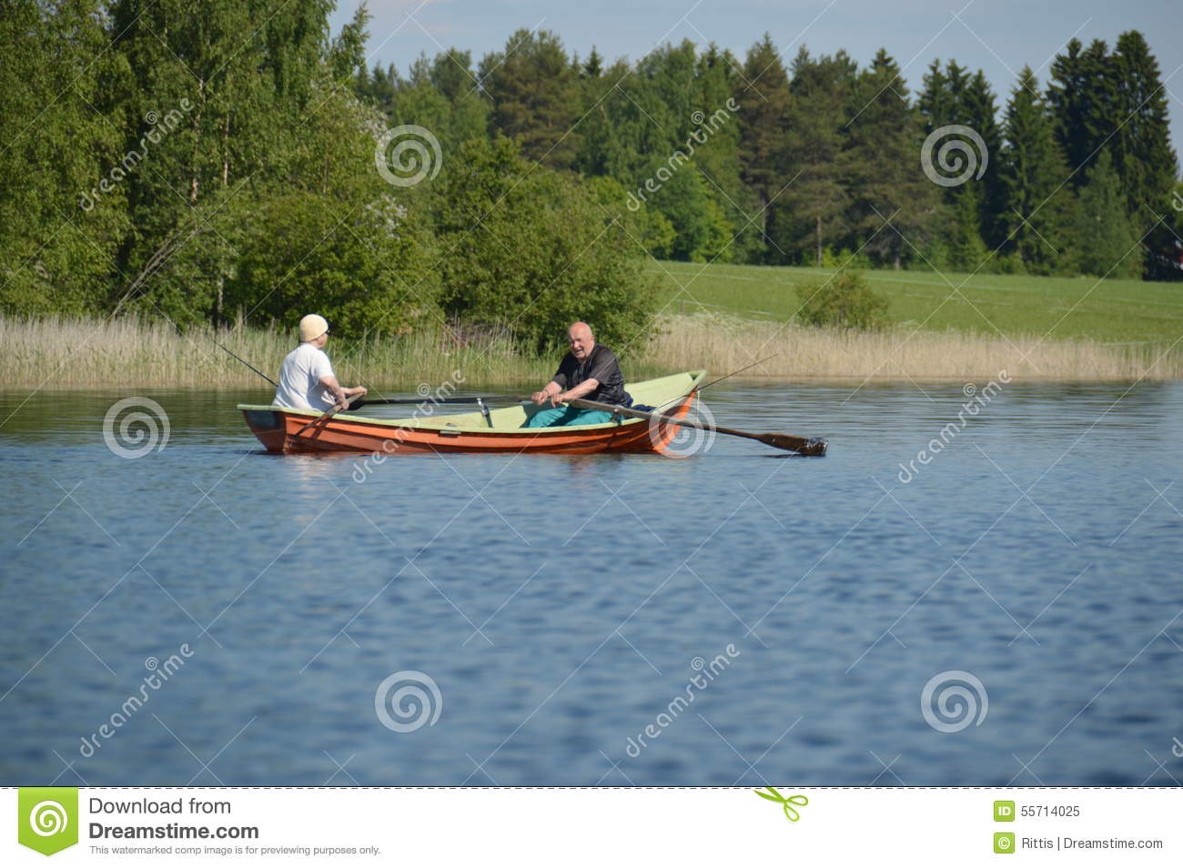 Senior hobbies elderly couple rowing in a boat with for Fishing row boats
