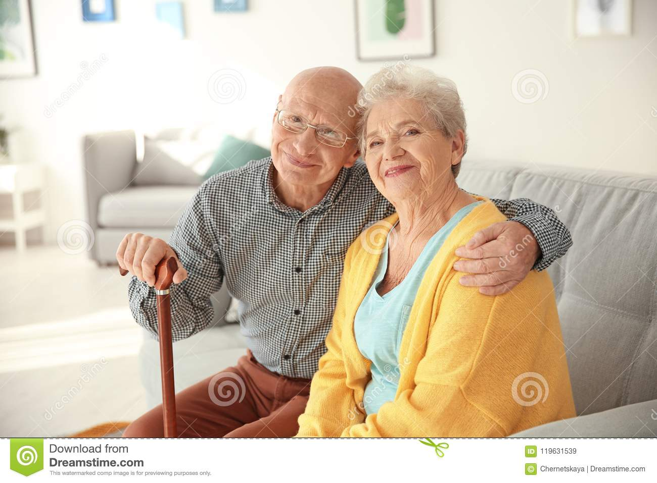 Download Elderly Couple Sitting On Couch Stock Image - Image of female, living: 119631539